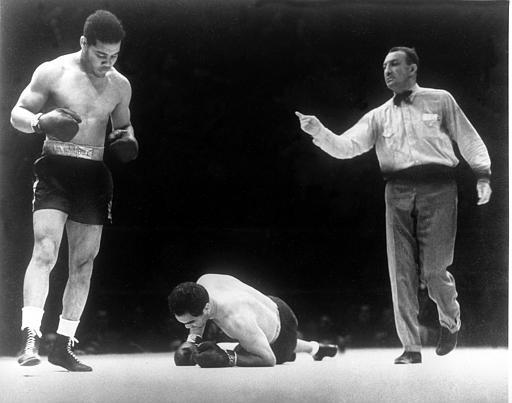 World heavyweight boxing champion Joe Louis stands over challenger Max Schmeling, who is down for a count of three. (AP Photo)