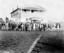 """Group of people standing in front of the Administration Building, which was the fourth building constructed at Fargo Agricultural School, circa 1920s."" Courtesy of the Arkansas History Commission."