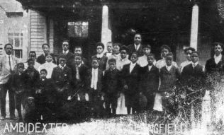"""Students and staff of the Ambidexter Institute, which operated at the Taylor House, 902 S. 12th St., from 1901 to 1908."" Photo Courtesy of the Sangamon County Collection at Lincoln Library"